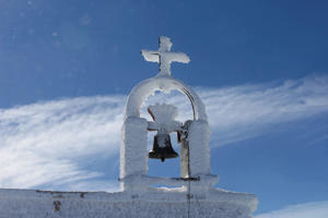 Snow covers a church bell in Kfardebian, Lebanon