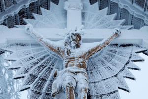 Snow covers a Jesus Christ figure near Szczyrk, Poland