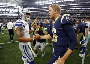 Dallas Cowboys' Dak Prescott, left, and Los Angeles Rams' Jared Goff, right, greet each other at midfield after their their NFL football game, Sunday, Oct. 1, 2017, in Arlington, Texas. (AP Photo/Ron Jenkins)