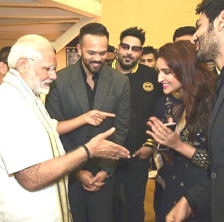 Image result for modi handshake to parineeti