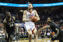 CHARLOTTESVILLE, VA - JANUARY 22: Virginia Cavaliers Forward Jay Huff (30) looks to shoot the ball with Wake Forest Demon Deacons Forward Sunday Okeke (34) and Wake Forest Demon Deacons Guard Brandon Children (0) defending during the first half of the Wake Forest Demon Deacons versus the Virginia Cavaliers game on January 22, 2019, at John Paul Jones Arena in Charlottesville, VA. (Photo by Gregory Fisher/Icon Sportswire via Getty Images)