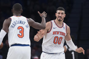 New York Knicks center Enes Kanter (00) and guard Tim Hardaway Jr. (3) celebrate after Kanter score a goal during the second half of an NBA basketball game against the Brooklyn Nets, Friday, Oct. 19, 2018, in New York. The Nets won 107-105. (AP Photo/Mary Altaffer)