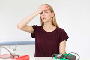 Female patient consulting for headache. (Photo by: BSIP/UIG via Getty Images)