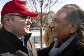 Guy Jones, left, and a supporter of President Donald Trump named Don embrace during a gathering of Native American supporters in front of the Catholic Diocese of Covington in Covington, Ky., Tuesday, Jan. 22, 2019. Jones organized Tuesday's gathering. (AP Photo/Bryan Woolston)