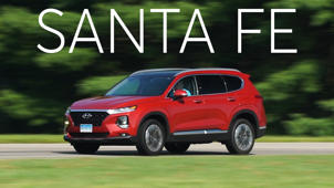 a car parked in the grass: 2019 Hyundai Santa Fe Quick Drive