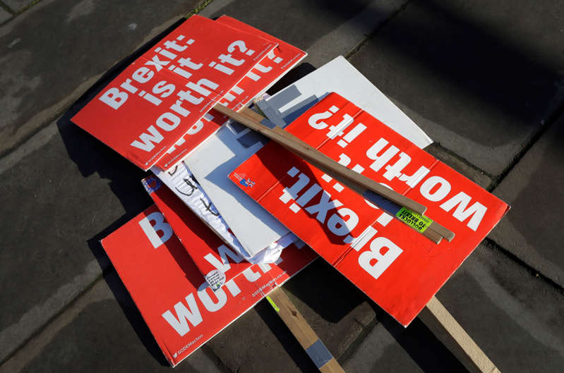Banners lie on the ground near parliament in London, Tuesday, Jan. 22, 2019. British Prime Minister Theresa May unveiled her Brexit Plan B on Monday — and it looks a lot like Plan A. May launched a mission to resuscitate her rejected European Union divorce deal, setting out plans to get it approved by Parliament after securing changes from the EU to a contentious Irish border measure. (AP Photo/Kirsty Wigglesworth)