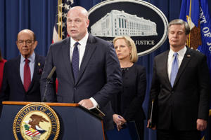 Acting Attorney General Matthew Whitaker,  Commerce Secretary Wilbur Ross (L), Homeland Security Secretary Kirstjen Nielsen and FBI Director Christopher Wray hold a news conference to announce indictments against China's Huawei Technologies Co Ltd, several of its subsidiaries and its chief financial officer Meng Wanzhou, in a pair of cases accusing the company of everything from bank and wire fraud to obstructing justice and conspiring to steal trade secrets from T-Mobile US Inc., at the Justice Department in Washington, U.S., January 28, 2019. REUTERS/Joshua Roberts