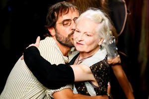 British designer Vivienne Westwood, right, is kissed by her husband Andreas Kronthaler at the end of Vivienne Westwood's Spring-Summer 2017 Ready to Wear fashion collection presented Saturday, Oct. 1, 2016 in Paris. (AP Photo/Francois Mori)