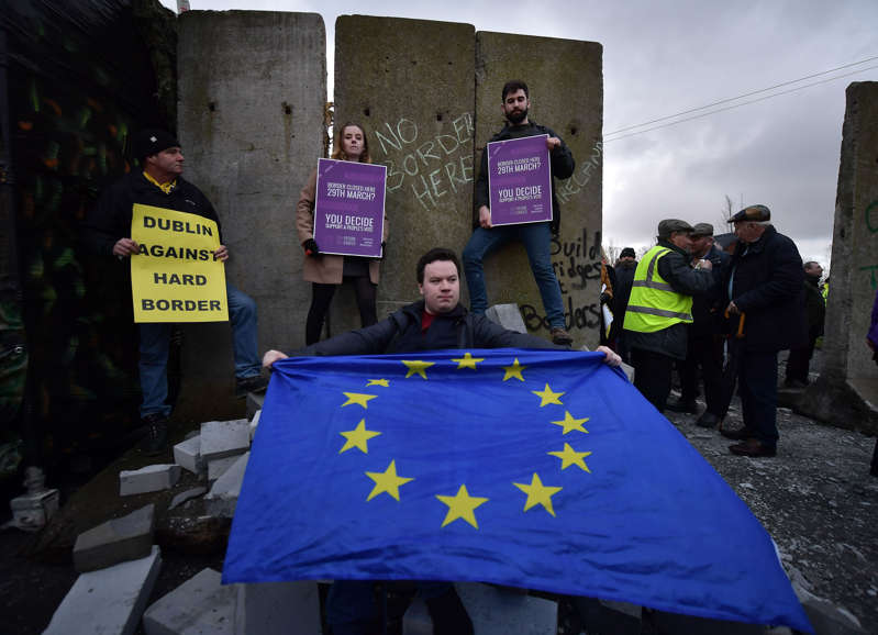 Members of Border Communities against Brexit gather at the Irish border