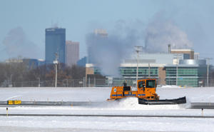Minneapolis/St. Paul International Airport grounds crews keep the runways clear of blowing snow on January 30, 2019 in Bloomington, Minnesota.