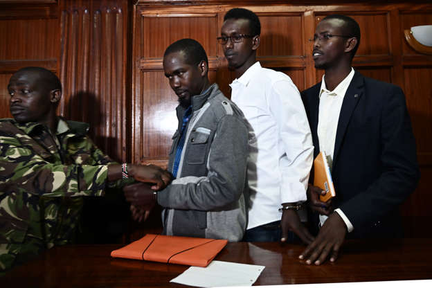 (From L) Mohamed Ahmed Abdi, Adan Mohamed Ibrahim and Hussein Hassan Mustafah, appear at the Milimani High Court in Nairobi, on January 14, 2019 in connection with the 2013 Westgate mall terror attack in Nairobi which caused more than 60 people dead. - The men are not accused of carrying out the attack, but of lending support to the gunmen. (Photo by SIMON MAINA / AFP)        (Photo credit should read SIMON MAINA/AFP/Getty Images)