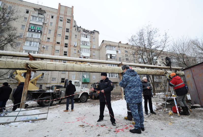Members of emergency services gather near a damaged apartment block after an apparent gas explosion in the town of Shakhty in Rostov Region, Russia January 14, 2019.