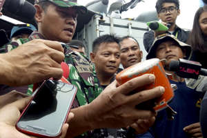Indonesian Navy Commander Rear Admiral Yudo Margin shows the recovered cockpit voice recorder of Lion Air flight 610 that crashed into the sea in October during a press conference on board of the navy ship KRI Spica in the waters off Tanjung Karawang, Indonesia, on Jan. 14. Navy divers have recovered the cockpit voice recorder in a possible boost to the accident investigation.