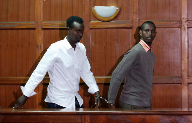 Suspects charged with helping al Qaeda-linked militants launch an attack on the Westgate mall Liban Abdullah Omar and Mohamed Ahmed arrive at the dock during the appearance for their case at the Milimani Law Courts in Nairobi