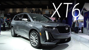 a car parked in front of a building: 2019 Detroit Auto Show: 2020 Cadillac XT6