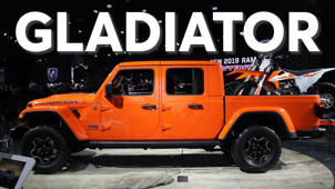 an orange and black truck parked in front of a sign: 2019 Detroit Auto Show: 2020 Jeep Gladiator