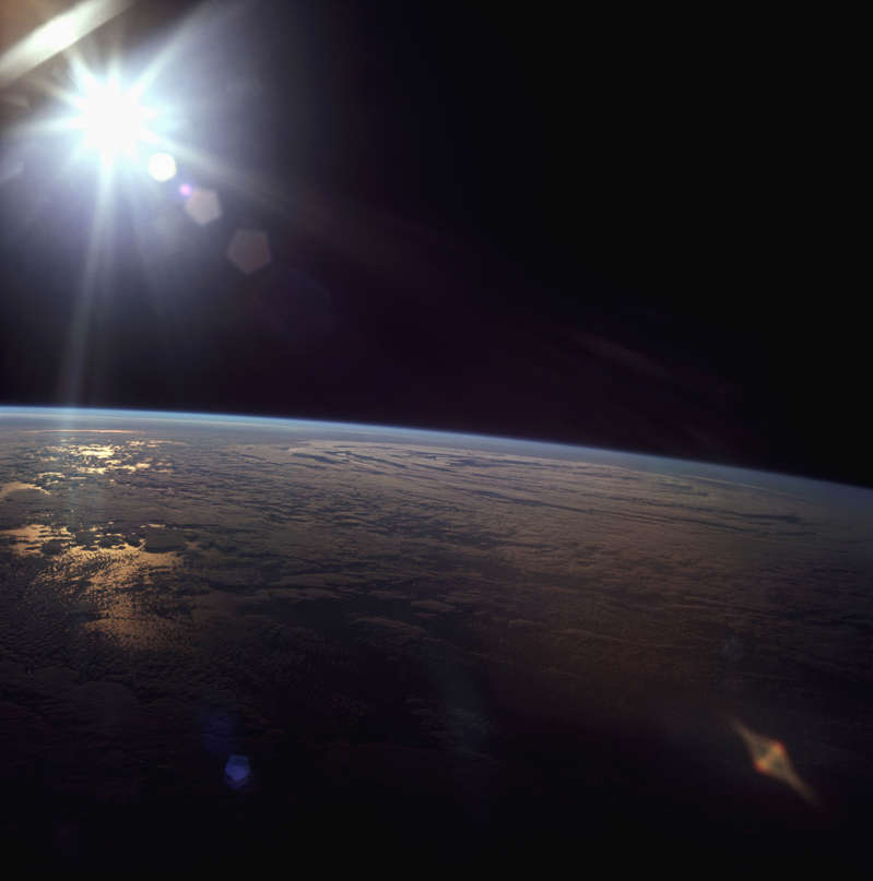 The sun shine on the surface of the Earth, seen from the Apollo 11 spacecraft. | Location: aboard Apollo 11, Earth orbit. (Photo by © Corbis/Corbis via Getty Images)