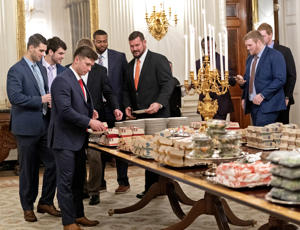 Members of the Clemson Tigers football team prepare to dine on fast food served by President Trump  to celebrate their Championship at the White House on January 14, 2019 in Washington, DC. (Photo by Chris Kleponis-Pool/Getty Images)