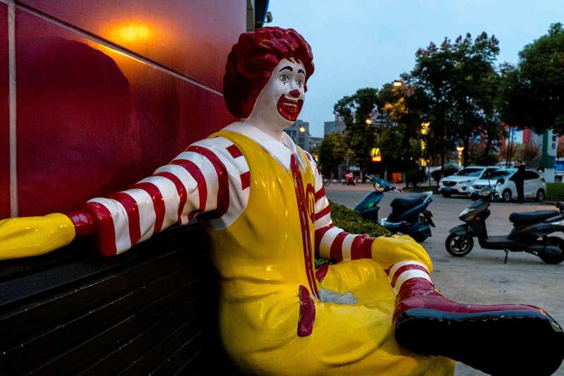 A c statue sits outside a McDonald's