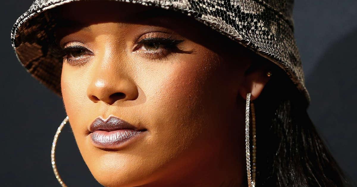 8126b5e390e62 Rihanna Sues Her Dad for  Fenty  Trademark Misuse