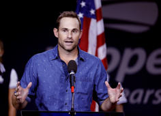 Andy Roddick speaks during a ceremony at the U.S. Open tennis tournament, Friday, Sept. 7, 2018, in New York. (AP Photo/Seth Wenig)