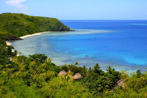 Paradise: aerial Fiji Yasawa islands view, deserted turquoise beach and bungalow palapas.