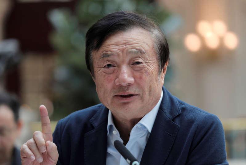 Ren Zhengfei, founder and CEO of Huawei, gestures during a round table meeting with the media in Shenzhen city, south China's Guangdong province, Tuesday, Jan. 15, 2019.