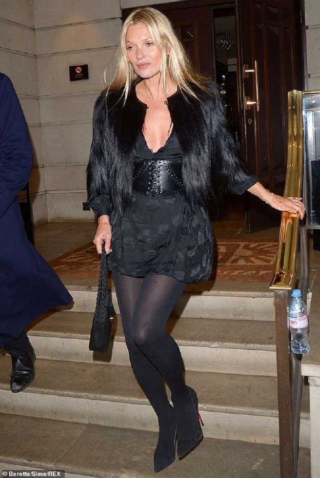 b5b3e4a85bb8 After years of wild nights Kate Moss shows kicking the booze has paid off  as she appears fresh-faced after leaving her 45th birthday party