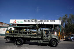 A military truck transporting soldiers is seen outside one of the access points of the state oil firm Petroleos Mexicanos (Pemex) refinery in Salamanca, in Guanajuato state, Mexico January 8, 2019. REUTERS/Daniel Becerril