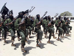 Hundreds of newly trained al-Shabab fighters perform military exercises in the Lafofe area some 18 km south of Mogadishu, in Somalia. Somali intelligence officials say the largest U.S. military airstrike against al-Shabab extremists in Somalia in nearly a year largely destroyed a training camp and killed more fighters than the U.S. announced.