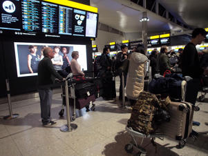 Passengers in Terminal 2 at Heathrow airport after departures were temporarily suspended following 'reports of drones' at the airport