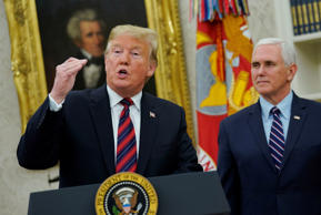 U.S. President Donald Trump delivers remarks on the humanitarian crisis on the Southern border and the shutdown as Vice President Mike Pence looks on at the White House in Washington, U.S., January 19, 2019. REUTERS/Yuri Gripas