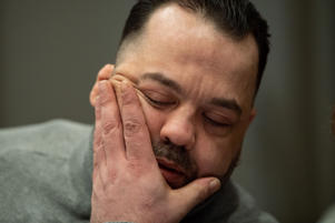 03 January 2019, Lower Saxony, Oldenburg: Niels Högel, accused of murdering 100 patients, is sitting in the courtroom on the day of the trial with his eyes closed and his hand on his face. Photo: Mohssen Assanimoghaddam/dpa (Photo by Mohssen Assanimoghaddam/picture alliance via Getty Images)