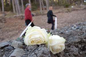 Relatives and friends of victims walk on the Col in Le Vernet, southwestern France, on March 24, 2016, in front of the mountain (background) were the plane of Germanwings crashed a year ago, to mark the first anniversary of the Germanwings tragedy in which a suicidal pilot crashed a plane into a mountainside, killing all 150 on board.The ill-fated plane took off from Barcelona and was headed to Dusseldorf in Germany when German co-pilot Andreas Lubitz, 27, drove it into the ground on March 24, 2015