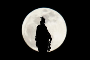 The Statue of Freedom on top of the US Capitol dome is seen silhouetted against the super moon on January 20, 2019 in Washington, DC. (Photo by Brendan Smialowski / AFP)        (Photo credit should read BRENDAN SMIALOWSKI/AFP/Getty Images)