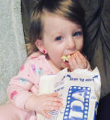 Baby messes with popcorn and upsets mom