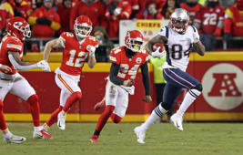 KANSAS CITY, MO - JANUARY 20: New England Patriots' Cordarrelle Patterson (84) takes the opening kickoff of overtime back for a gain. The Kansas City Chiefs host the New England Patriots in an NFL AFC Championship game at Arrowhead Stadium in Kansas City, MO on Jan. 20, 2019. (Photo by Jim Davis/The Boston Globe via Getty Images)