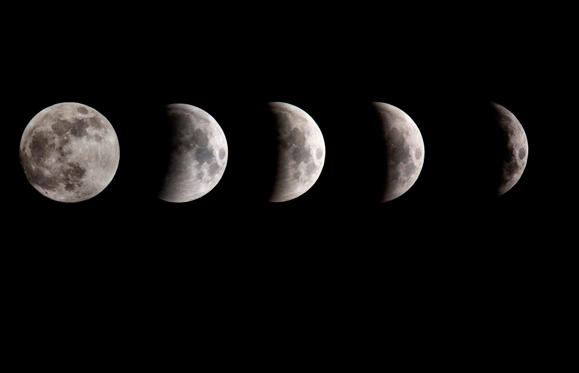 Slide 1 de 52: MANCHESTER,  UNITED KINGDOM - JANUARY 21:  A composite image shows the Earth's shadow beginning to cross the surface of the moon during the partial eclipse phase of the lunar eclipse on January 21, 2019 in Manchester, United Kingdom. (Photo by Anthony Devlin/Getty Images)