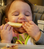 Eating while sleeping? This baby can do both!