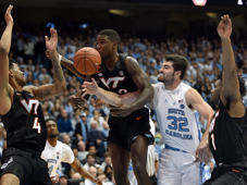 CHAPEL HILL, NORTH CAROLINA - JANUARY 21: Ty Outlaw #42 of the Virginia Tech Hokies battles Luke Maye #32 of the North Carolina Tar Heels for a rebound during the second half of their game at the Dean Smith Center on January 21, 2019 in Chapel Hill, North Carolina. North Carolina won 103-82. (Photo by Grant Halverson/Getty Images)
