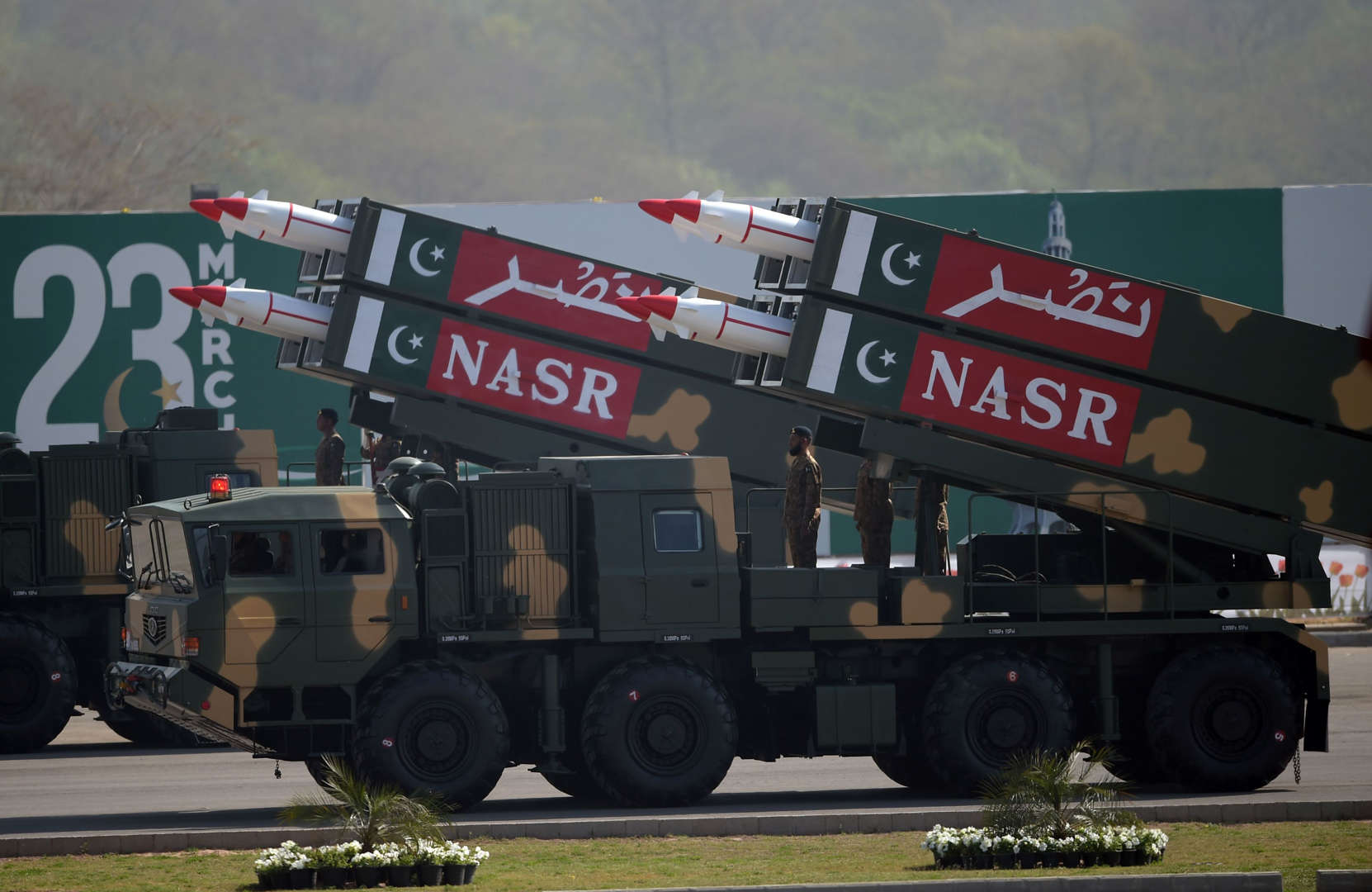 File: Pakistani military personnel stand beside short-range Surface to Surface Missile NASR during a Pakistan Day military parade in Islamabad on March 23, 2017.