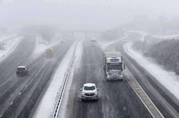 Snow way home: Thousands of drivers are TRAPPED on 'ice rink