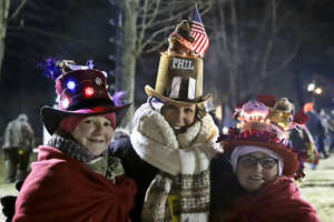 Lisa Gibson, center, and her daughters Josie, left, and AneGiguere of Pittsburgh, arrive early to celebrate the 133rd Groundhog Day on Gobbler's Knob in Punxsutawney, Pa. Saturday, Feb. 2, 2019. It is the second Groundhog Day trek to Gobbler's Knob for the family.