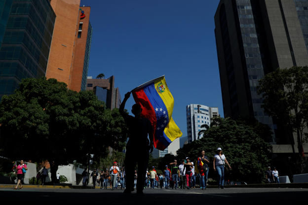 Opposition supporters take part in a rally against Venezuelan President Nicolas Maduro's government in Caracas, Venezuela February 2, 2019. REUTERS/Carlos Barria