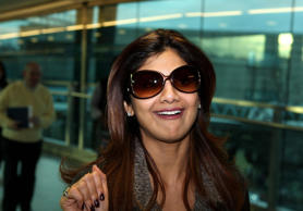 Shilpa Shetty walks through Terminal 3 at Heathrow Airport in west London after arriving in the UK.   (Photo by Steve Parsons - PA Images/PA Images via Getty Images)