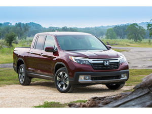 a car parked in a field: 2019 Honda Ridgeline