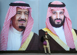 A Pakistani man waits for transport in front of billboards showing portraits of Saudi Arabian Crown Prince Mohammed bin Salman (R) and his father and Saudi Arabia's King Salman bin Abdulaziz displayed on a street ahead of the prince's arrival in Islamabad on February 15, 2019. - Pakistan is preparing to welcome Saudi Arabian Crown Prince Mohammed bin Salman for a state visit over February 16 and 17, the foreign ministry confirmed as Islamabad hopes to sign various investment deals to prop up its slumping economy. (Photo by AAMIR QURESHI / AFP)        (Photo credit should read AAMIR QURESHI/AFP/Getty Images)