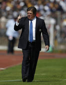 America's Miguel Herrera coach shouts instructions to his players during a Mexico soccer league match against the Pumas, in Mexico City, Sunday, Jan. 21, 2018. (AP Photo/Eduardo Verdugo)
