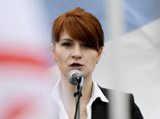 FILE - In this April 21, 2013 file photo, Maria Butina, leader of a pro-gun organization in Russia, speaks to a crowd during a rally in support of legalizing the possession of handguns in Moscow, Russia. Federal prosecutors concede that they misinterpreted text messages when they alleged that Butina, a Russian woman accused of working as a secret agent traded sex for access. Prosecutors acknowledged the mistake in a court filing in the case of Butina, charged with working as a covert agent and trying to establish back-channel lines of communication to the Kremlin. (AP Photo/File)