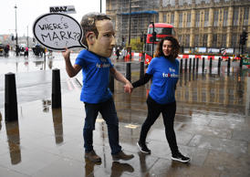 An actor dressed as Mark Zuckerberg arrives at Portcullis House, London, where a hearing is taking place on the impact of disinformation on democracy. (Photo by Kirsty O'Connor/PA Images via Getty Images)